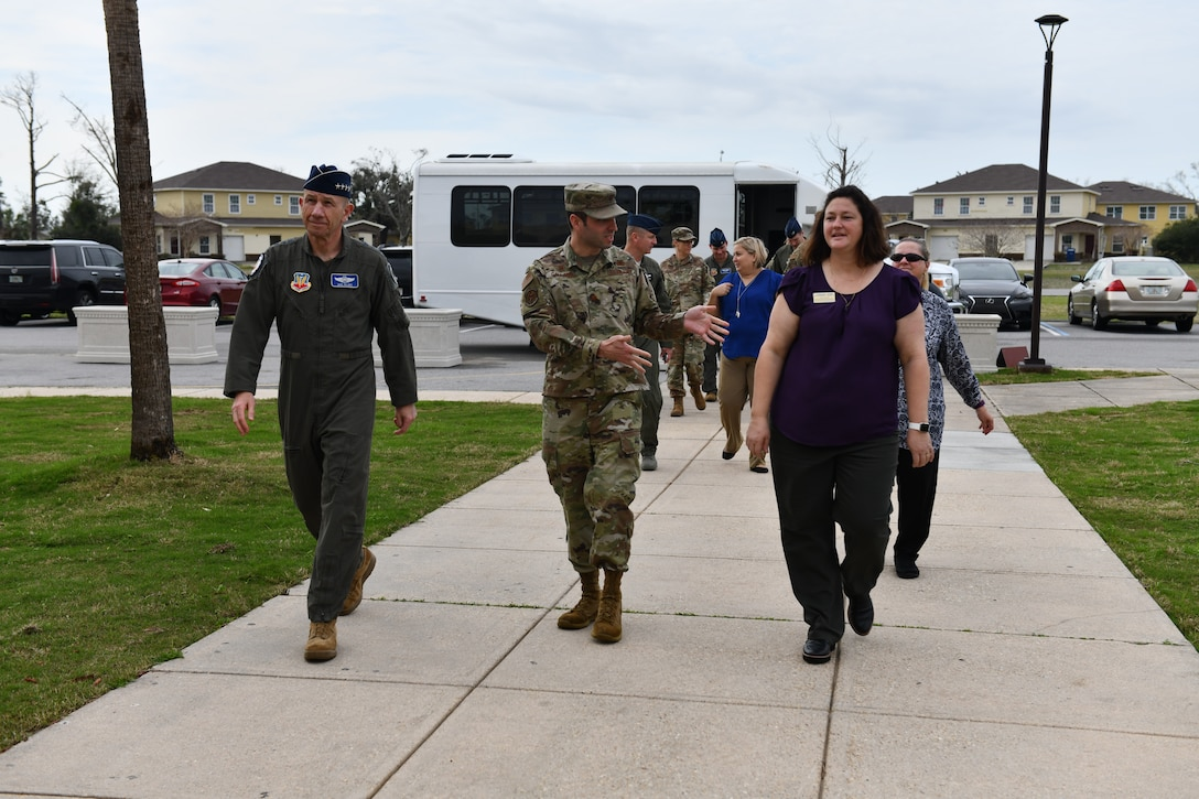 U.S. Air Force Gen. Mike Holmes, the commander of Air Combat Command (left), walks up to the Child and Youth Program Center with U.S. Air Force Maj. Jesse Calland, 325th Force Support Squadron commander (middle), and Cynthia Dedeo, 325th FSS recreation specialist at Tyndall Air Force Base, Florida, Feb. 25, 2020. Holmes toured Tyndall and spoke with leaders and Airmen about what the future has in store for the 325th Fighter Wing. (U.S. Air Force photo by Senior Airman Stefan Alvarez)