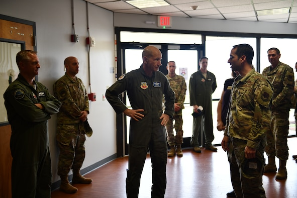 U.S. Air Force Gen. Mike Holmes, the commander of Air Combat Command (center), talks to Maj. Jesse Calland, 325th Force Support Squadron commander, about future plans for the Child and Youth Program Center at Tyndall Air Force Base, Florida, Feb. 25, 2020. Holmes toured Tyndall and spoke with leaders and Airmen about what the future has in store for the 325th Fighter Wing. (U.S. Air Force photo by Senior Airman Stefan Alvarez)