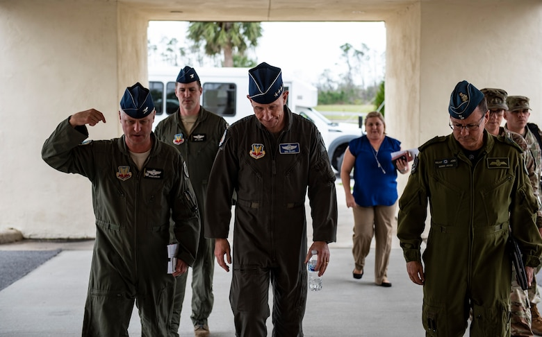 U.S. Air Force Col. Brian Laidlaw, 325th Fighter Wing commander (left), walks with U.S. Air Force Gen. Mike Holmes, the commander of Air Combat Command (center), and Royal Canadian Air Force Major-General Derek Joyce, Continental North American Aerospace Defense Command Region deputy commander (right), to a town hall at Tyndall Air Force Base, Florida, Feb. 25, 2020. Holmes outlined his vision for the future of Tyndall and how the base's mission fits into ACC's priorities. (U.S. Air Force photo by Staff Sgt. Magen M. Reeves)