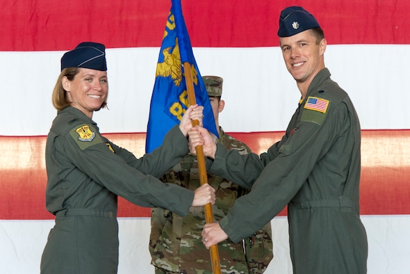 Lt. Col. Justin Wetterhall, 86th Flying Training Squadron commander, receives the guideon from Col. Carey Jones, 47th Operations Group commander, at Laughlin Air Force Base, Texas, Feb. 25, 2020. During the change of command ceremony, Wetterhall received the guideon, rendered his first salute, and discussed the squadron's future during a quick speech to attendees.