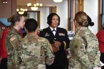 U.S. Army Reserve Brig. Gen. Patricia Wallace, Deputy Commanding General, 88th Readiness Division, speaks with Soldiers, assigned to the 85th U.S. Army Reserve Support Command, during the Operation HerStory all-female Honor Flight news conference at Pritzker Military Library, in Chicago, February 25, 2020.
