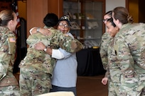 Amelia Cunningham, U.S. Air Force veteran, receives a hug from an Army Reserve Master Sgt. Lawanda Nelson during the Operation HerStory all-female Honor Flight news conference at Pritzker Military Library, in Chicago, February 25, 2020.