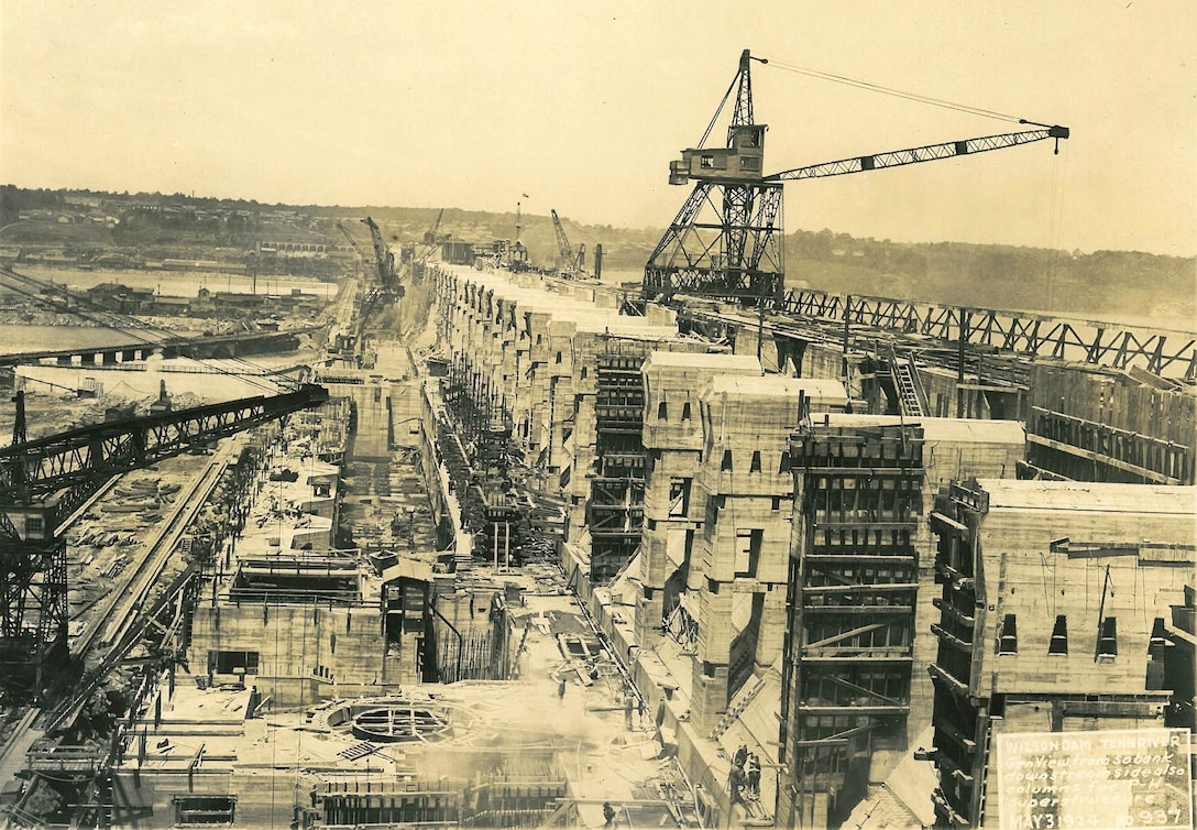 U.S. Army Corps of Engineers Nashville District Historical Photo - This is a view from the south bank of the Tennessee River of ongoing construction of Wilson Dam May 3, 1924.