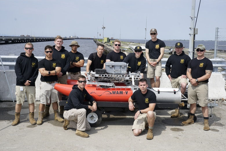 U.S. Army dive team members pause for a photo during training on the U.S. Army Engineer Research and Development Center's Coastal and Hydraulics Laboratory's Multifunctional Assessment Reconnaissance Vessel II