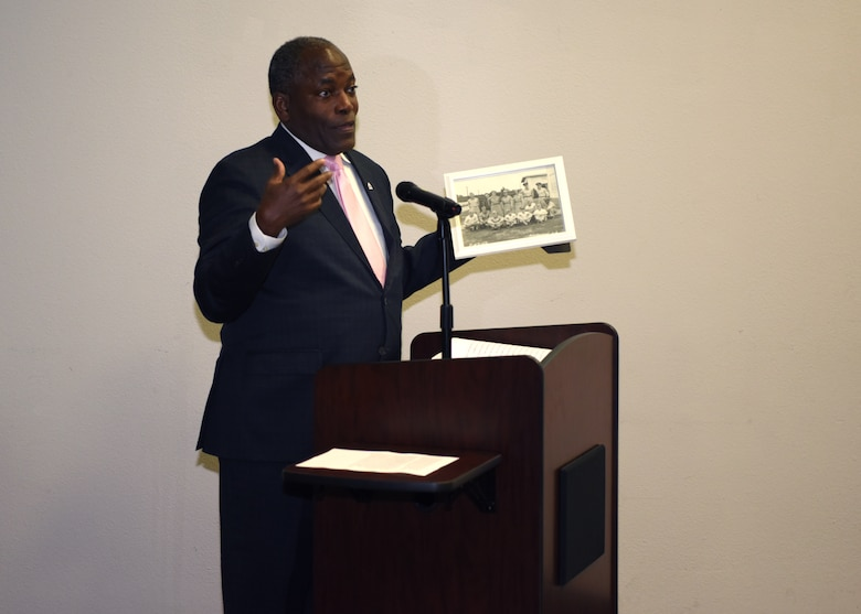 Retired Lt. Gen. Ronnie D. Hawkins, Jr. presents a photo of his father at Goodfellow Air Force Base in 1950 at the Black History Month event in the event center on Goodfellow Air Force Base, Texas, February 20, 2020. Hawkins spoke on the importance of black history in our military and the importance of diversity. (U.S. Air Force photo by Airman 1st Class Ethan Sherwood)