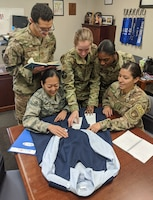 Air University Squadron Officer School students Capt. James Flores-Lombay, Capt. Jessica Sunkamaneevongse, Capt. Kristen Ricker, Capt. Tanisha Bramwell-Boose and Air Force Office of Special Investigations Special Agent Alexandra Garced signed up to take the Air University Advanced Research elective to research a redesign of the maternity service dress uniform. The Diversity and Inclusion topic of the elective also includes researching how to reimburse the cost of shipping mother's milk home for female Airmen on short temporary duty assignments. The two topics are being studied at the request of the Air Force Women's Initiative Team, which promotes diversity and inclusion in the Air Force. (Courtesy photo)