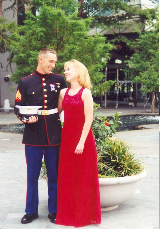 Master Sgt. Matthew Sheley embracing his wife, Andrea.