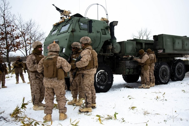 U.S. Marines from Tango Battery, 3rd Battalion, 12th Marine Regiment, discuss the results after conducting a fire mission with the M124 High Mobility Artillery Rocket System during exercise Northern Viper on Yausubetsu Training Area, Hokkaido, Japan, Feb. 5, 2020. Northern Viper is a regularly scheduled bilateral training exercise that includes artillery elements. These elements provide combined arms support to infantry units, maximizing the warfighting and maneuver capabilities of the Marine Corps. (U.S. Marine Corps photo by Lance Cpl. Jackson Dukes)