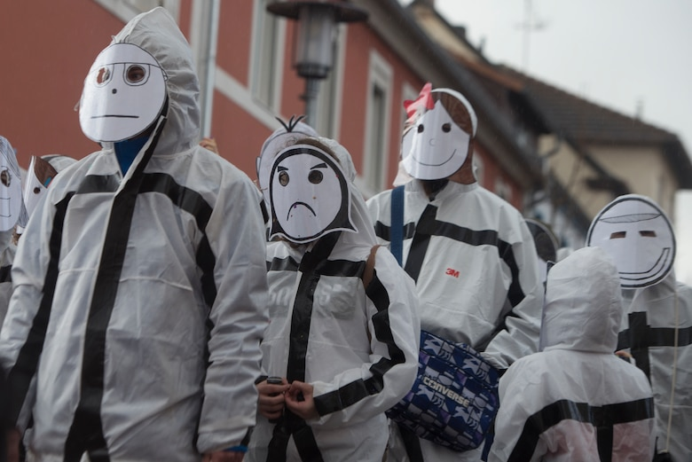People participate in a Fasching parade.