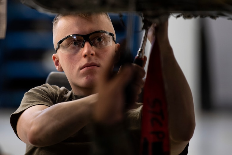 U.S. Air Force Senior Airman Tanner Sterner, 52nd Maintenance Squadron aerospace propulsion journeyman, manually rotates jet engine components during an inspection at Spangdahlem Air Base, Germany, Feb. 25, 2020. Sterner helped check for discrepancies to prevent issues arising. The 52nd MXS Propulsion Flight recently won the Air Force Chief of Safety: Aviation Safety award for their excellent record of quality assurance. (U.S. Air Force photo by Airman 1st Class Valerie Seelye)