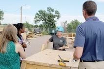Angela Nitz, a student in the Home Builders Institute 12-week training construction class at Fort Carson, Colo., explains what she learns about home building during the class Aug. 20, 2019. (Photo Credit: Eric E. Parris )