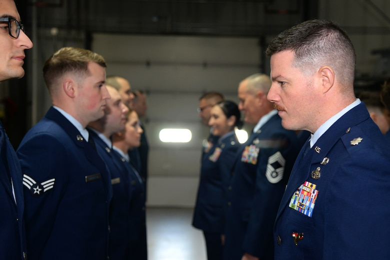 A picture of U.S. Air Force Lt. Col. Brian T. Cooper, commander of the 177th Maintenance Group, performing an open ranks inspection.