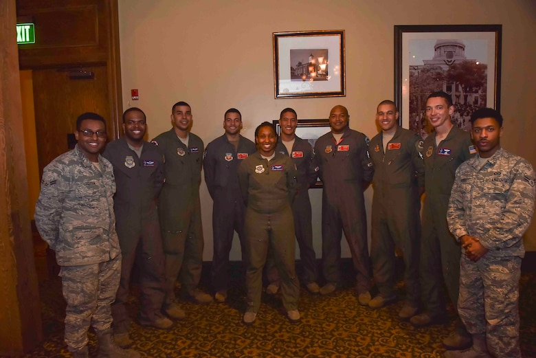 U.S. Air Force Airmen, assigned to the 187th Fighter Wing, Alabama Air National Guard, pose for a photo with Airmen from Fairchild Air Force Base, Wash., in Montgomery, Alabama, Feb. 18, 2020. A KC-135R Stratotanker from Fairchild AFB refueled 187th FW F-16 Fighting Falcons during an all-black aircrew sortie in honor of Black History Month. (U.S. Air Force photo by Airman 1st Class Kiaundra Miller)