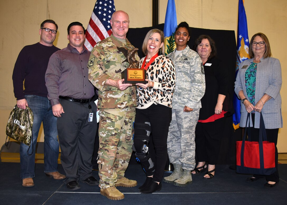 Julie Humphrey receives the 2019 507th Air Refueling Wing Spouse of the Year award from Col. Miles Heaslip, 507th ARW commander, during the 2019 Annual Awards Banquet Feb. 8, 2020, at Tinker Air Force Base, Oklahoma. (U.S. Air Force photo by Tech. Sgt. Samantha Mathison)