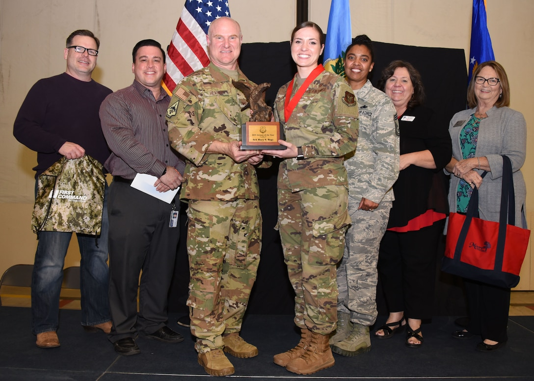 Senior Airman Mary Begy, 507th Air Refueling Wing Public Affairs broadcaster, receives the 2019 507th ARW Airman of the Year award from Col. Miles Heaslip, 507th ARW commander, during the 2019 Annual Awards Banquet Feb. 8, 2020, at Tinker Air Force Base, Oklahoma. (U.S. Air Force photo by Tech. Sgt. Samantha Mathison)