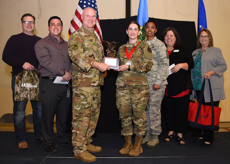 Master Sgt. Madison Harmon, 730th Air Mobility Training Squadron, receives the 2019 507th ARW SNCO of the Year award from Col. Miles Heaslip, 507th ARW commander, during the 2019 Annual Awards Banquet Feb. 8, 2020, at Tinker Air Force Base, Oklahoma. (U.S. Air Force photo by Tech. Sgt. Samantha Mathison)