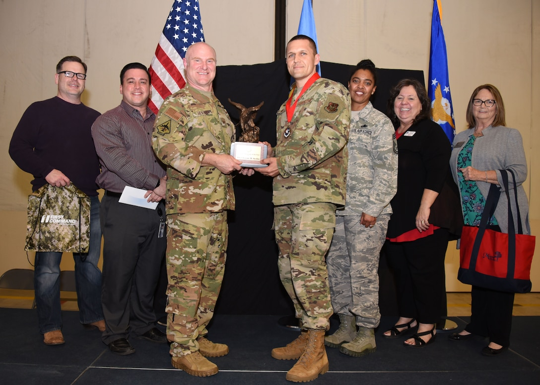 Master Sgt. Jeremy Scoles, 507th Logistics Readiness Squadron first sergeant, receives the 2019 507th ARW First Sergeant of the Year award from Col. Miles Heaslip, 507th ARW commander, during the 2019 Annual Awards Banquet Feb. 8, 2020, at Tinker Air Force Base, Oklahoma. (U.S. Air Force photo by Tech. Sgt. Samantha Mathison)