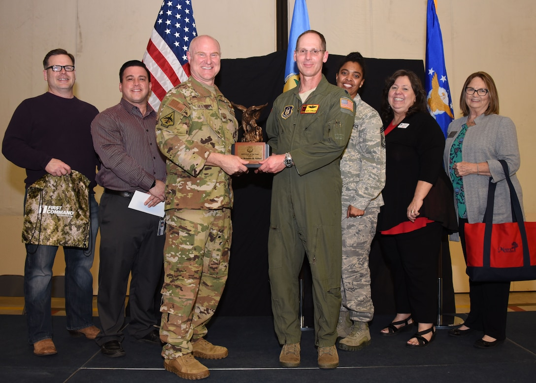 Lt. Col. Marvin Ashbaker, 465th Air Refueling Squadron director of operations, receives the 2019 507th ARW CGO of the Year award on behalf of Capt. Brenden Valenti, 465th ARS mobility pilot, from Col. Miles Heaslip, 507th ARW commander, during the 2019 Annual Awards Banquet Feb. 8, 2020, at Tinker Air Force Base, Oklahoma. (U.S. Air Force photo by Tech. Sgt. Samantha Mathison)