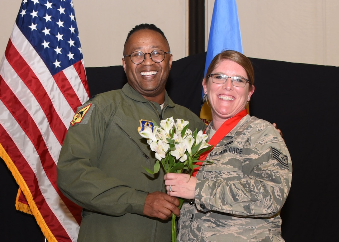 Tech. Sgt. Bridget Goodknight, 507th Medical Squadron NCOIC outpatient records, is recognized by Lt. Col. Alvin Bradford, 507th MDS commander, during the 2019 Annual Awards Banquet Feb. 8, 2020, at Tinker Air Force Base, Oklahoma. (U.S. Air Force photo by Tech. Sgt. Samantha Mathison)