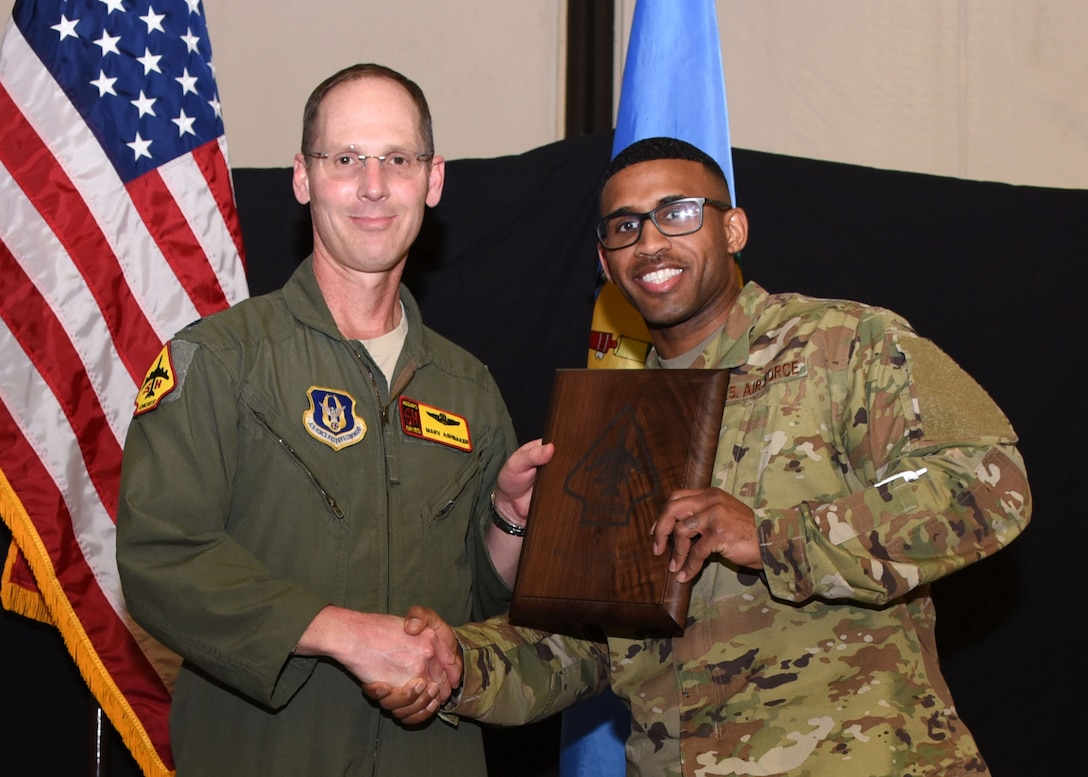 Tech. Sgt. Leon Pennyfeather, 507th Operations Support Squadron, receives the 2019 507th Operations Group Okie MVP award from Lt. Col. Marvin Ashbaker, 465th ARS director of operations, during the 2019 Annual Awards Banquet Feb. 8, 2020, at Tinker Air Force Base, Oklahoma. (U.S. Air Force photo by Tech. Sgt. Samantha Mathison)