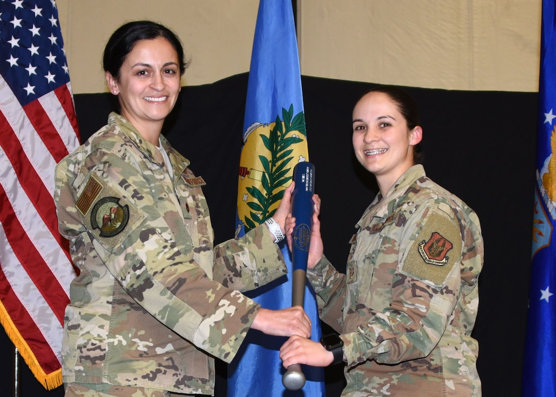 Tech. Sgt. Nathalie Hamilton, 507th Aircraft Maintenance Squadron, receives the 2019 507th AMXS Heavy Hitter Award from Maj. Cassandra Espy, 507th AMXS commander, during the 2019 Annual Awards Banquet Feb. 8, 2020, at Tinker Air Force Base, Oklahoma. (U.S. Air Force photo by Tech. Sgt. Samantha Mathison)