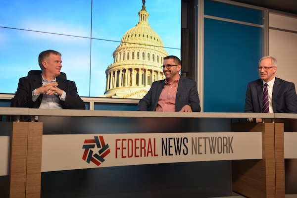 Defense Intelligence Agency Deputy Chief Information Officer Doug Cossa, center, participates with other panelist in an interview with the Federal News Network, Feb. 19. (Photo by Ally Rogers, DIA)