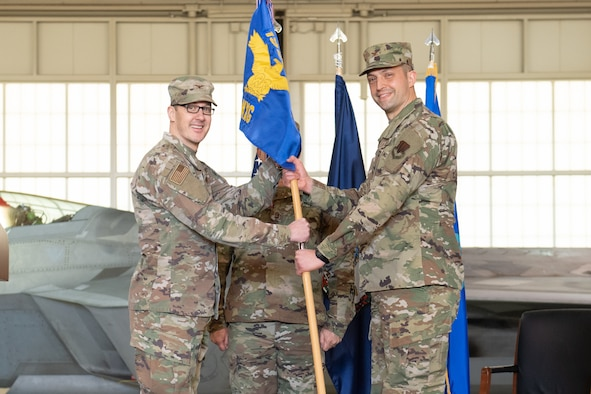 Two officers exchange guidon flag