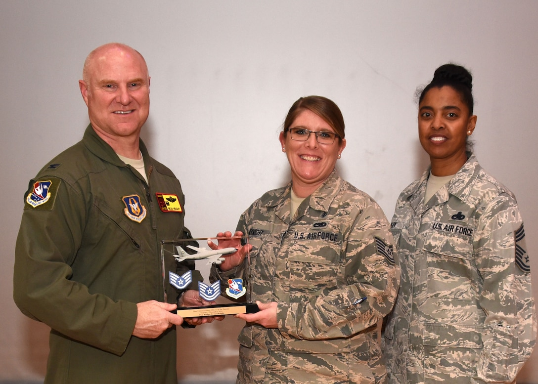 Tech. Sgt. Bridget Goodknight, 507th Medical Squadron NCOIC Outpatient Records, receives the NCO of the Quarter award for the fourth quarter during the February UTA commander's call at the base theater, Feb. 9, 2020, Tinker Air Force Base, Oklahoma. (U.S. Air Force photo by Tech. Sgt. Samantha Mathison)