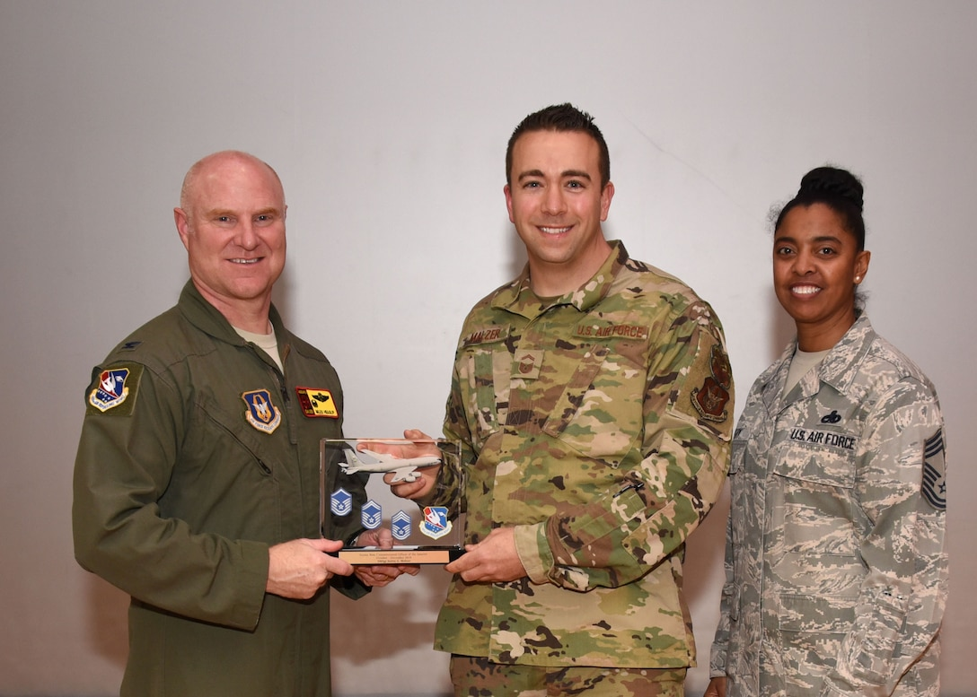 Senior Master Sgt. Justin Malzer, 507th Air Refueling Wing Inspector General Inspections, receives the SNCO of the Quarter award for the fourth quarter during the February UTA commander's call at the base theater, Feb. 9, 2020, Tinker Air Force Base, Oklahoma. (U.S. Air Force photo by Tech. Sgt. Samantha Mathison)