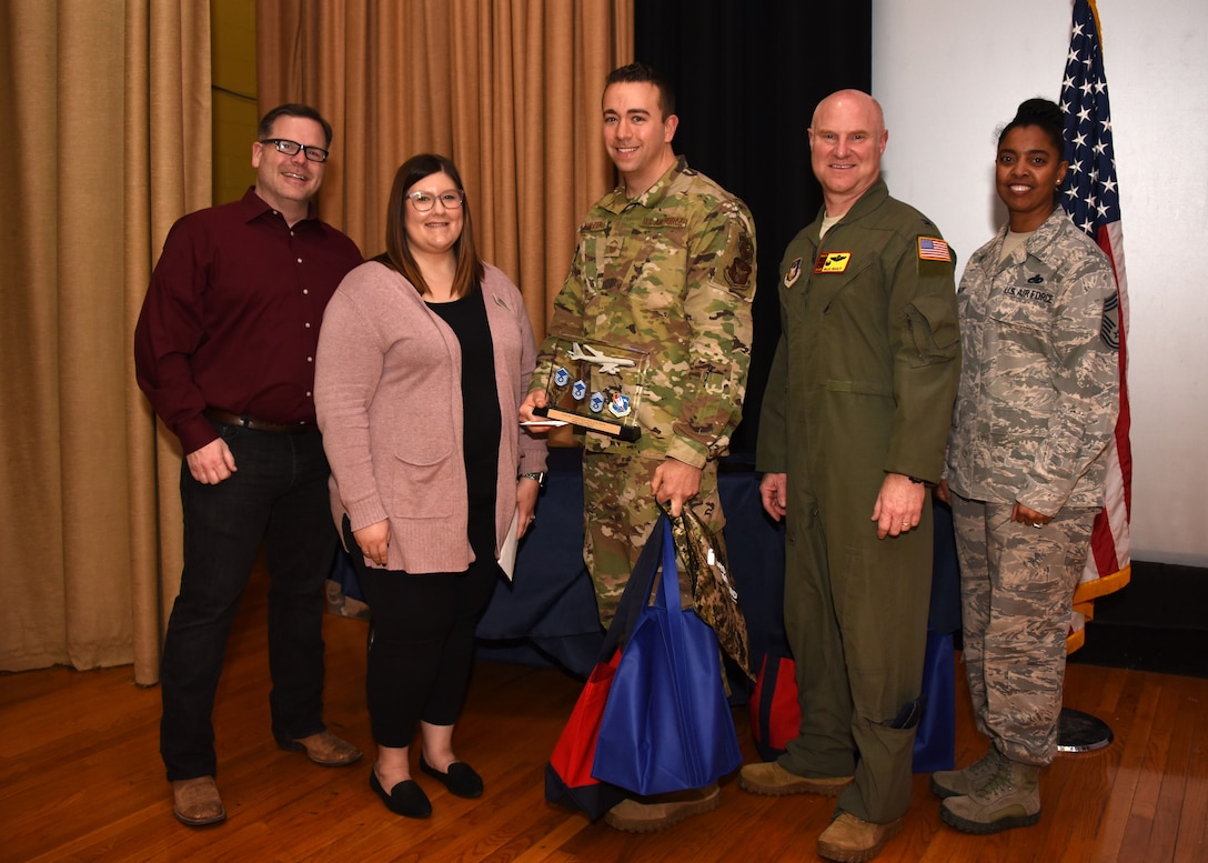Senior Master Sgt. Justin Malzer, 507th Air Refueling Wing Inspector General Inspections, stands with 507th ARW leadership and community partners after receiving the SNCO of the Quarter award for the fourth quarter during the February UTA commander's call at the base theater, Feb. 9, 2020, Tinker Air Force Base, Oklahoma. (U.S. Air Force photo by Tech. Sgt. Samantha Mathison)