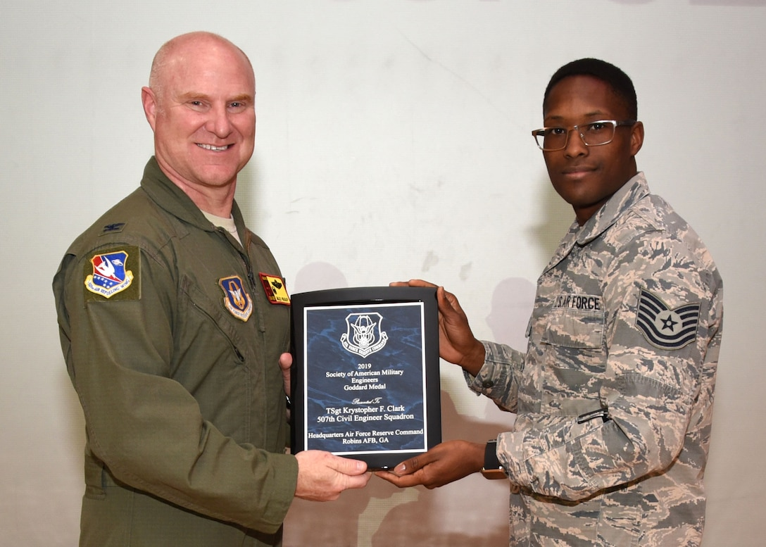 Tech. Sgt. Krystopher Clark, 507th Civil Engineer Squadron, receives the 2019 Society of American Military Engineers Goddard Medal from Col. Miles Heaslip, 507th Air Refueling Wing commander, Feb. 9, 2020, at Tinker Air Force Base, Oklahoma. (U.S. Air Force photo by Tech. Sgt. Samantha Mathison)