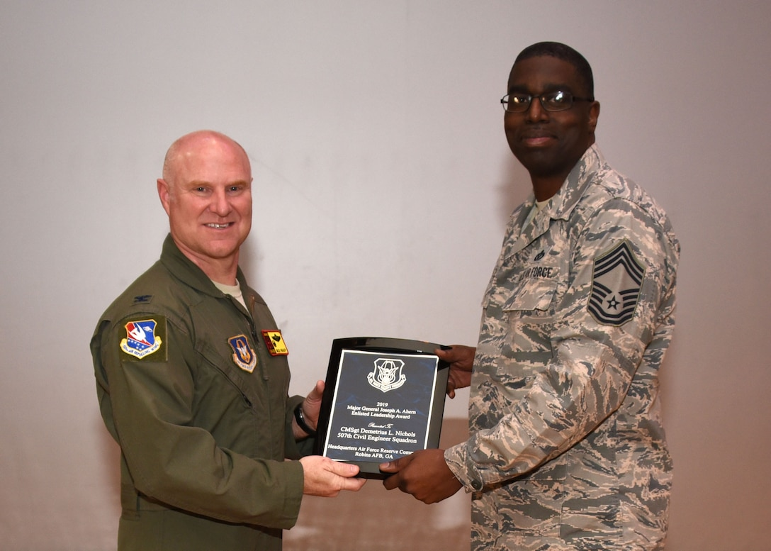 Chief Master Sgt. Demetrious Nichols, 507th Civil Engineer Squadron, receives the 2019 Major General Joseph Ahem Enlisted Leadership Award from Col. Miles Heaslip, 507th Air Refueling Wing commander, Feb. 9, 2020, at Tinker Air Force Base, Oklahoma. (U.S. Air Force photo by Tech. Sgt. Samantha Mathison)