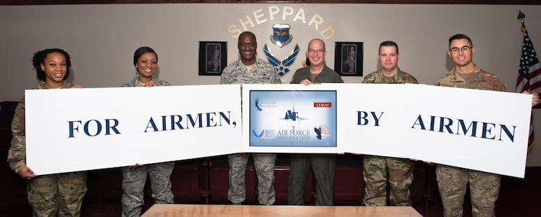 Sheppard's Air Force Assistance Fund leaders pose for a photo with the 82nd Training Wing and 80th Flying Training Wing commanders and command chiefs at Sheppard Air Force Base, Texas, Feb. 27, 2020. The AFAF charitable drive will kick off March 2 through April 10, 2020. (U.S. Air Force photo by Senior Airman Pedro Tenorio)