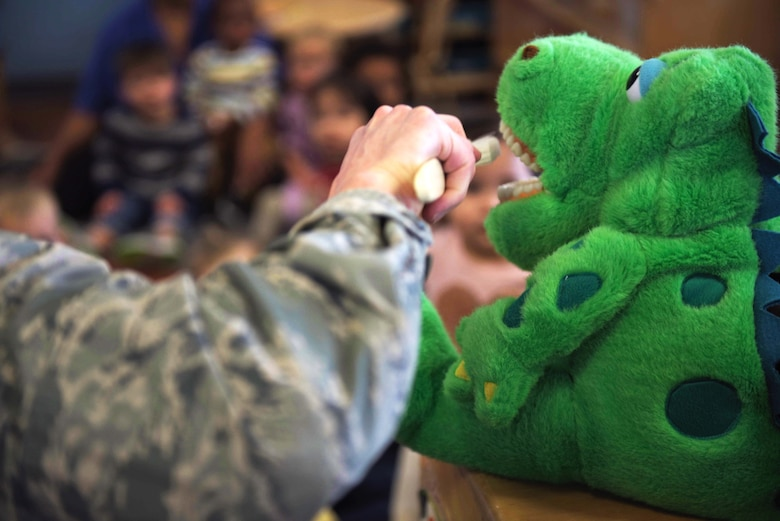 U.S. Air Force Maj. Nicholas Einbender, 325th Medical Group dentist, pretends to brush the teeth of a puppet during a dental demonstration at Tyndall Air Force Base, Florida, Feb. 27, 2020. February is National Children's Dental Health Month, and the 325th MDG's dental team reached out to the 325th Force Support Squadron's Child and Youth Program Center (formerly known as the Child Development Center) to teach young children the importance of brushing and flossing teeth. (U.S. Air Force photo by Staff Sgt. Magen M. Reeves)