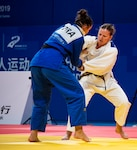 U.S. Army Capt. Anna Feygina, United States Armed Forces Military World Games team judo competitor, attempts to throw an opponent during the Conseil International du Sport Militaire Judo competion in Wuhan China, Oct. 20, 2019. The 7th MWG will feature military athletes from around the world with an estimated participation of more than 100 nations and more than 10,000 participants. (U.S. Department of Defense photo by Staff Sergeant James R. Crow)