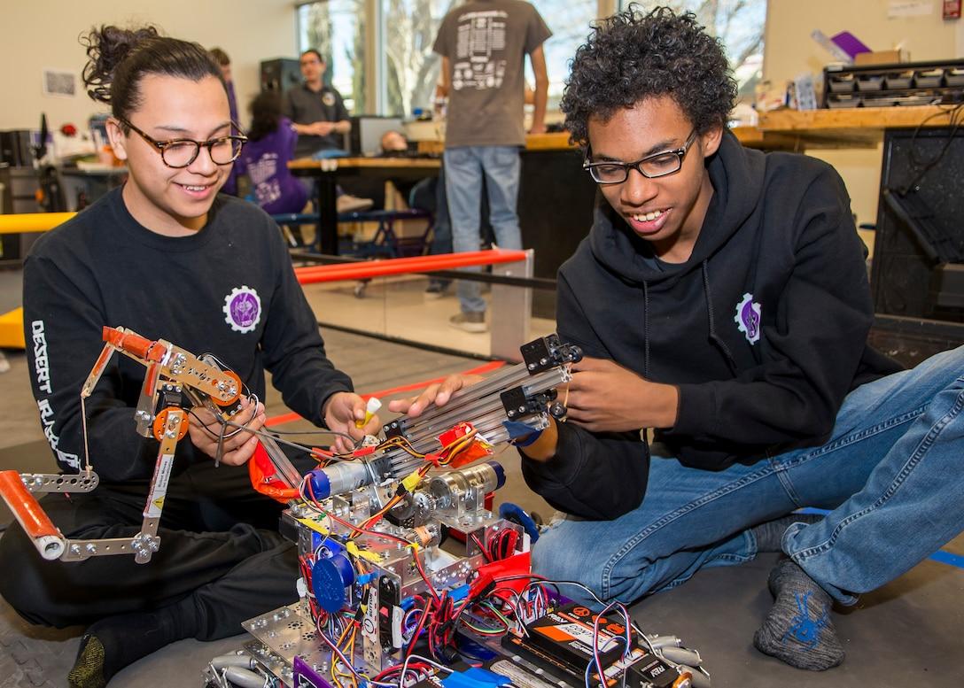 Scorpion Robotics Club Team 7227 members Juan Carlos Garcia and Eloy Fernandez work on improving their robot at Desert Junior-Senior High School on Edwards Air Force Base, California, Feb. 12. (Air Force photo by Giancarlo Casem)