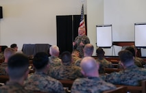 U.S. Marine Corps Maj. Gen. Paul J. Rock, commanding general of 3D Marine expeditionary Brigade, introduces Brig. Gen. William J. Bowers, commanding general of Marine Corps Installations Pacific, the speaker for this professional military education training at Camp Courtney, Okinawa, Japan, Feb. 24, 2020. Bowers covered the Battle of Guadalcanal and its relevance to operations today. (U.S. Marine Corps photo by Lance Cpl. Francesca Landis)