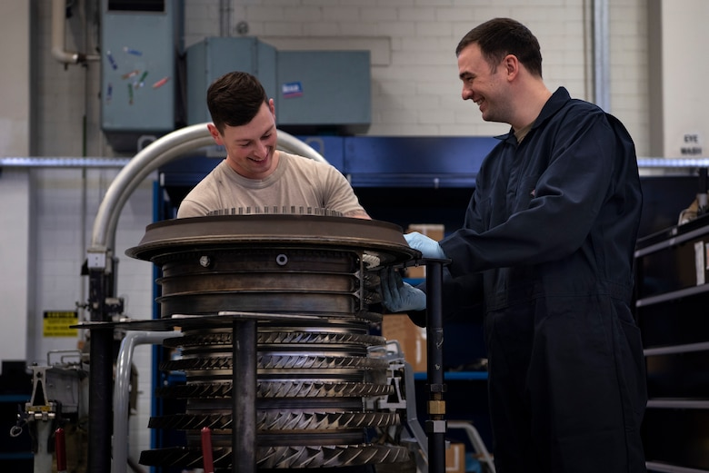 U.S. Air Force Staff Sgts. John Roberts and Taylor Bowes, both 52nd Maintenance Squadron aerospace propulsion craftsmen, build an F110-GE-100 jet engine compressor at Spangdahlem Air Base, Germany, Feb. 25, 2020. The propulsion flight is in charge of providing engines to multiple units, not just the 52nd Fighter Wing. GE-100 series engines are not used at Spangdahlem AB, but are sent to Aviano AB, Italy, and the U.S. Air Forces Central Command theater of operations. (U.S. Air Force photo by Airman 1st Class Valerie Seelye)