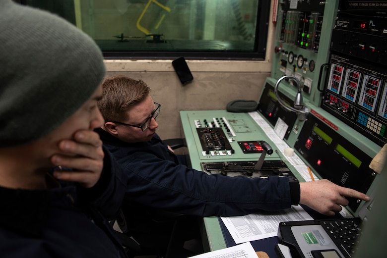 U.S. Air Force Staff Sgt. Dustin Gaskins, 52nd Maintenance Squadron aerospace propulsion craftsman, left, and Tech. Sgt. Aaron Filkins, 52nd MXS test cell shift supervisor, monitor engine performance during test operations at Spangdahlem Air Base, Germany, Feb. 25, 2020. The test cell is used to make sure jet engines are in quality-working order after being built or repaired. (U.S. Air Force photo by Airman 1st Class Valerie Seelye)