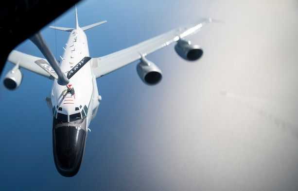 """A U.S. Air Force RC-135 Rivet Joint assigned to the 95th Reconnaissance Squadron receives fuel from a KC-135 Stratotanker from the 100th Air Refueling Wing, RAF Mildenhall, England, Feb. 26, 2020. The 100th ARW is the only permanent U.S. air refueling wing in the European theater, providing the critical air refueling """"bridge,"""" which allows the Expeditionary Air Force to deploy around the globe at a moment's notice. (U.S. Air Force photo by Tech. Sgt. Emerson Nuñez)"""