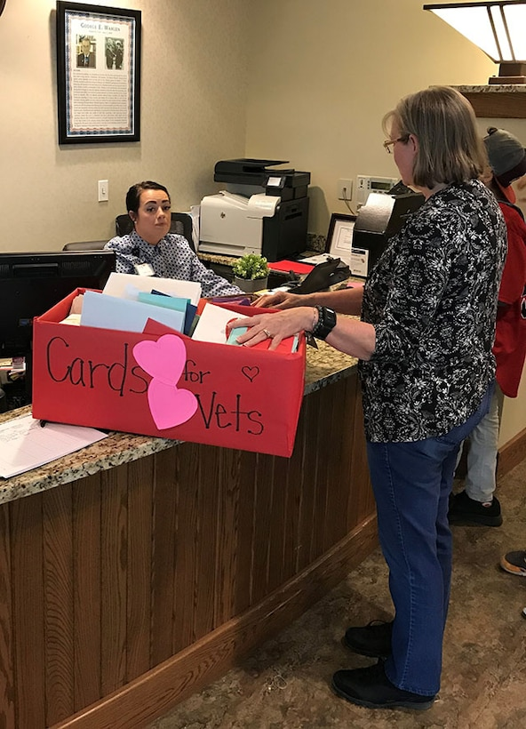Employee can box of valentines to receptionist at veterans home