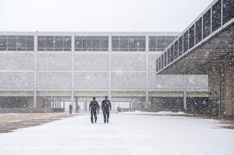 Cadets cross the terrazzo braving winter weather