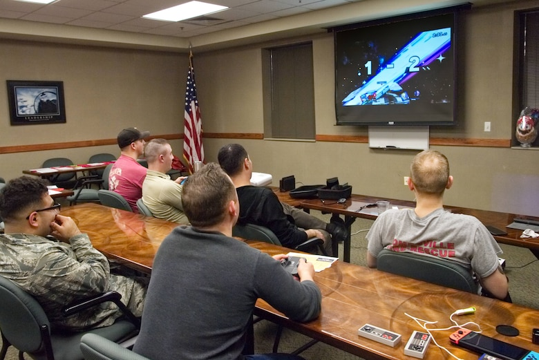 Airmen from Grissom Air Reserve Base, Ind., participate in a Super Smash Bros. tournament held by Airman & Family Readiness, Feb. 8, 2020. Master Sgt. Hansel Orozco, 434th Air Refueling Wing religious affairs superintendent, organized the tournament as part of his second game night event.