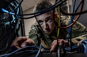 Tech. Sgt. Andrew Wilson, 911th Communications Squadron mission defense team member, checks the connection of wires on a server at the Pittsburgh International Airport Air Reserve Station, Pennsylvania, Feb. 4, 2020.