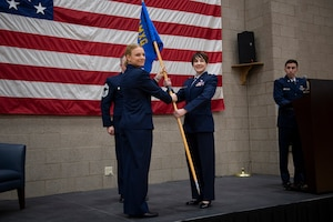 Maj. Shelly A. Martin, 911th Maintenance Squadron commander, receives the squadron guidon from Lt. Col. Katrine Waterman, 911th Maintenance Group commander, during an assumption of command ceremony at the Pittsburgh International Airport Air Reserve Station, Feb. 8, 2020.