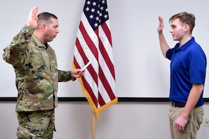 Lt. Col. Jason D. Price, commander of the 911th Security Forces Squadron, administers the Oath of Enlistment for Raymond Gonzalez at the Pittsburgh International Airport Air Reserve Station, Pennsylvania, Jan. 31, 2020.
