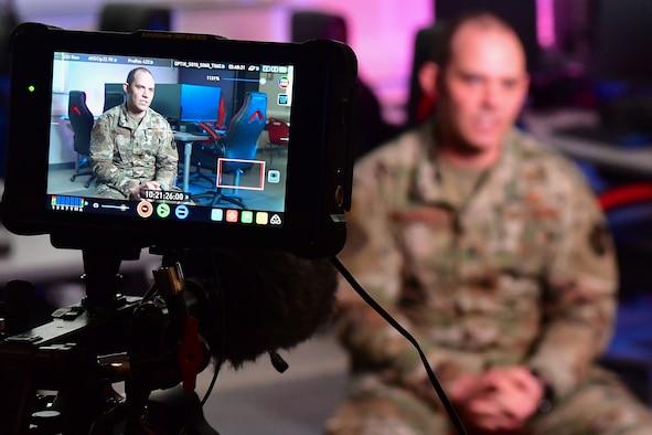 The Association of Defense Communities interviews U.S. Air Force 1st Lt. Thomas Van Dorple, 223rd Cyberspace Operations Squadron flight commander, at Jacksonville High School.