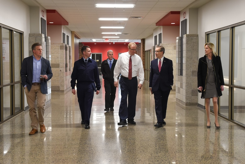Col. John Schutte, 19th Airlift Wing commander, along with members of the Association of Defense Communities tours Jacksonville High School in Jacksonville, Arkansas.