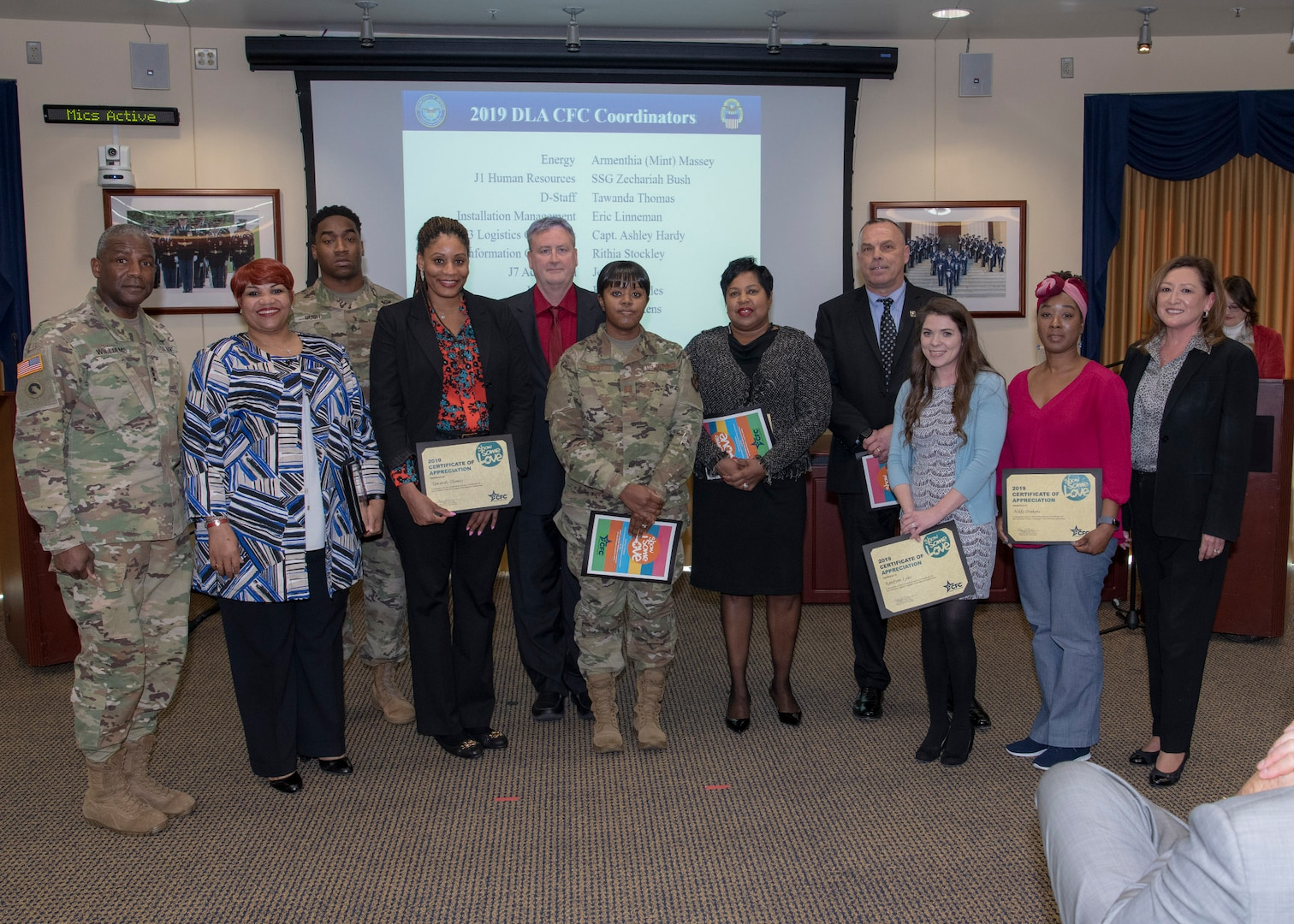 Three men and six women pose with the DLA Director and DLA Acquisition Deputy Director during the CFC closing ceremony.