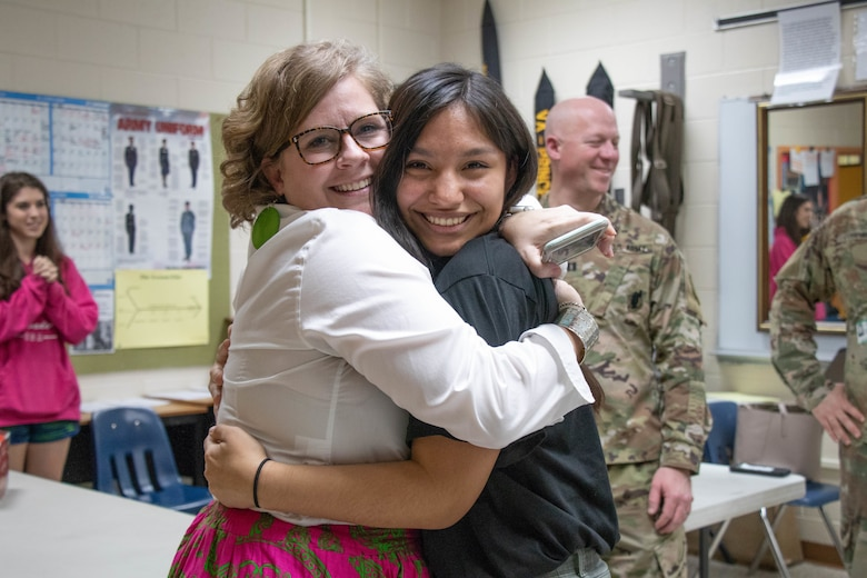 Ms. Catherine Pope (left), assistant principal at Prince George High School, hugs Future Soldier Emily Guzman Morales (right) after Guzman recited her Oath of Enlistment Feb. 26, 2020 at Prince George High School